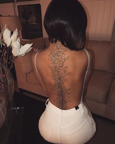 Wings Tattoo Ideas And Their Meanings Dope Tattoos, Girl Spine Tattoos, Back Tattoo Women Spine, Flower Spine Tattoos, Great Tattoos, Beautiful Tattoos, Body Art Tattoos, Girl Tattoos, Back Tattoo Girls