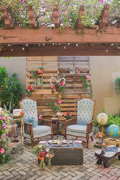This colorful garden-inspired lounge area is full of quirky flair. Incorporate personal elements, such as vintage armchairs and globes, for your own personal touch.Related: 101 Ways to Personalize Your Wedding