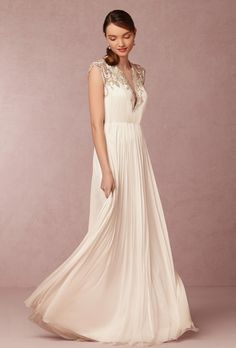 Brides: BHLDN. Intricate gown with a plunging neckline, beaded embellishment illusion back and silk tulle skirt.