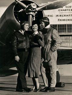 """Spencer Tracy, Myrna Loy, Clark Gable  ------Actress Myrna Loy (1905-1993), with actors Clark Gable (1901-1960) and Spencer Tracy (1900-1967), in Victor Fleming's film, """"Test Pilot,"""" 1938."""