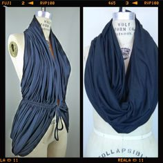 Multiway infinity scarf / vest black A multi purpose scarf made of super soft modal. Can we worn as a loop scarf, halter top, shrug etc... Your imagination is the only limit! Genevieve Accessories Scarves & Wraps