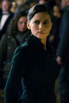 """""""Played memorably by Elena Anaya, our big screen Doctor Poison is now called Isabelle Maru, and may be the most frightening version yet. With her primitive facial prosthetic and raspy voice, both due to the horrific scarring one has to assume was a result of her work, she comes off as vulnerable and haunted. However, that vulnerability helps mask the real darkness she hides within. She's a reinterpretation of the character that could only work in the film's WWI setting, and yet with chemical…"""