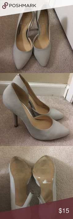 BCBG Paris light Grey heels Final Price! These are in good condition they are used made out of Suede leather upper. Very light grey color. There are a few things there's a spots on the back of the heels that is peeling a little bit can't tell when you wear them. A few spots that are a lil darker from wear. Still wearable. Also some wear at the bottom of the sole. 4 1/2 inch heels. A wrinkle on the sides of the inside of the shoe as shown in picture. No box is included BCBG Shoes Heels