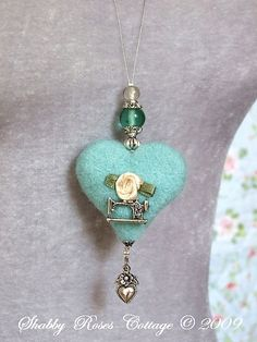 wouldn't use the sewing machine but it does give me some ideas- little heart and beads are great.