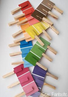 Color matching game using paint chips and clothes pins.. GENIUS.  Keeps your kiddo busy, quiet, HAPPY and focused :)