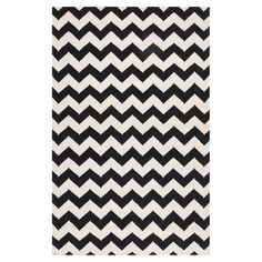Anchor your living room seating group or define space in the den with this hand-woven wool rug, featuring a bold chevron motif.   P...