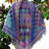 """Knit this gorgeous striped blanket in Noro Kureyon, literally """"Crayon"""" in Japanese. It's just bursting with color! Free Shipping on USA orders over $75."""