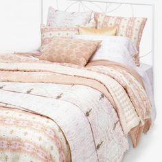 abc Co-Create Eskayel Shamsun Pink Bedding lLighting the way, a warm haze of desert sun inspires a palette of desaturated dusky hues. influenced by native american design and tribal patterns, hand-painted and symmetrically abstract creations cover organic cotton voile and evoke the feelings of summer sunsets.