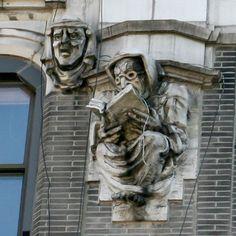 The creepy book reading gargoyle at West 181st Street, NY