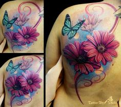 I like the realism of the flowers and butterfly but don't care fore the blue or scroll work.