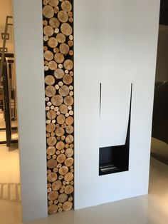 We like the idea of this inset for firewire as a design element next to the M-bedroom fireplace