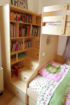Vertical rods embedded into the book case act as handrails so that kids can get up and down safely.