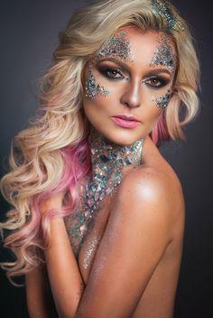 Beauty makeup, big waves, pink hair, smokey eyes, glitter, face jewel, body jewel.