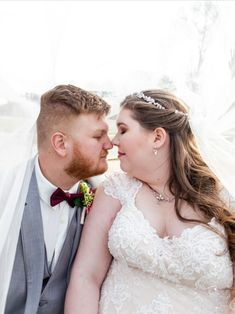 This bride and groom give each other sweet nose kisses in this wedding photo. MKM Photography, a wedding photography company based in Durham North Carolina, perfectly captures the love between the newlyweds. We love how the brides veil hugs the couple. This wedding photo is soft, light and airy.