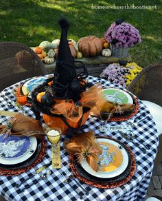 Med Pumpkin wrapped in orange tulle tied with black ribbon or gauze, Witch's hat on top of pumpkin , add black spiders and ravens, Plates from HomeGoods, Black Acrylic chargers- Party City, Tablecloth- Kohls, Placemats and napkin rings-Pier 1
