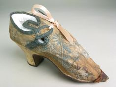 Women's shoes, silk damask lined with linen and bound with silk ribbon with leather heel and toe covers and sole, 1715-20, British. Previously believed to have belonged to Oliver Cromwell's daughter-in-law.