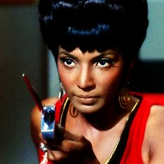 Uhura, Mirror Universe<<<uh noooo, that's regular bad-ass Uhura. She's just dressed like that cuz the mirror universe has the girl officers dressed like that, she's just defending herself from the jerk Sulu of the mirror universe. Don't mess with her!