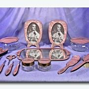 www.rubylane.comPearlized Colored Pink Celluloid 15 Piece Vanity Dresser Set c.1930's