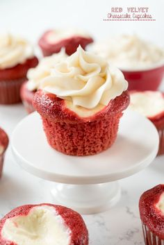 Red Velvet Cream Cheese Cupcakes - these easy cupcakes are completely from scratch. Red Velvet Cake filled with cheesecake and topped with cream cheese frosting - an amazing cupcake recipe!: