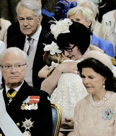 Princess Estelle of Sweden hugging her paternal grandmother Ewa Westling during the Christening of her brother Prince Oscar. May 27 2016