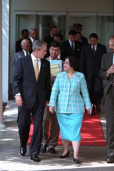 President George W. Bush and President Megawati Sukarnoputri of Indonesia walk along the Colonnade at the White House.