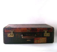 Vintage distressed suitcase -- great for use as a display or prop, by RecycleBuyVintage, $50.00.