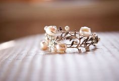 This as an engagement ring with rubies or emerald stones or light pink diamonds!!! <3