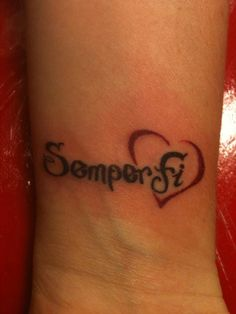 Semper Fi Tattoo. But I'd have it in all white ink, and the words curving above the heart.