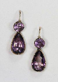 These fine gold,amethyst earrings are Georgian, circa 1790.  These earrings have faceted amethysts that are foil back and have hand crimped collets.  They are day/night earrings, so called because the bottom drop is removable for daytime wear if so desired. How rare to find a pair of 18th century earrings that are completely original and in excellent condition.  Elegant, simple and rare. England circa 1790