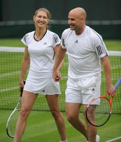 Andre and Steffi, at Wimbledon playing a mixed doubles exhibition match against Tim Henman and Kim Clijsters.