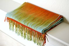 Hand woven long scarf made in pooling technique. This means that color is gradually changes from #blue to #orange and #red colors. Also there is a thin tencel thread in golden... #kgthreads #accessories #cozy #fall #fashion #gift #gradient #green #unisex #women #wrap