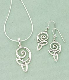 "Spiral and Knot Jewelry A spiral, signifying growth, spins into a trinity knot, symbol of eternity - a spirit journeying into the infinite. Sterling silver, pendant on 18"" chain."