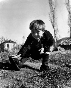 """David Seymour,  Oxia ,Greece. 1949.  Elefteria, the only child not evacuated from her remote village during the ravages of the civil war there, receives her first pair of shoes from UNICEF. Chim wrote his own caption for the picture: """"For a long time four-year old Elefteria just stared at the new shoes. Finally, her grandmother was allowed to put them on her feet. Then the ice was broken. Elefteria ran through the village, laughing with delight. Her happiness was absolutely perfect."""""""