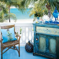 I'm going to do this to my folding side table...  Don't stick to just one shade. Layer a variety of blues and greens on painted furniture to provide depth and visual interest. Distressing the surface with sandpaper or even judicious taps from a hammer allows multiple colors to shine through   CoastalLiving.com