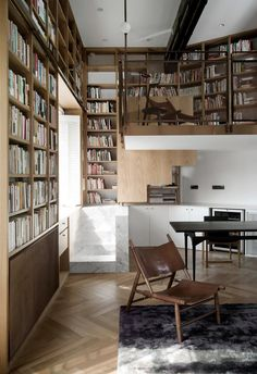 Shanghai Apartment Lined With Floor-To-Ceiling Bookshelves by Atelier TAO+C | https://www.yellowtrace.com.au/shanghai-apartment-floor-ceiling-bookshelves-atelier-taoc/
