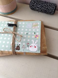 cute gift wrap package with twine and clothespin (ooh just gave me an idea to use a mini clothespin to pin a little card to a gift!)