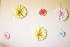 Inexpensive decorations for a party!  Make accordion paper flowers!