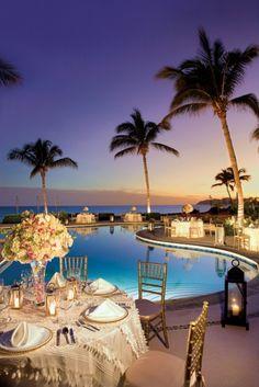 A wedding reception set up around the pool at Zoetry Casa del Mar Los Cabos