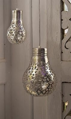 DIY: spray paint a doily onto a lightbulb--when the light shines through, it will cast a cool pattern on the wall