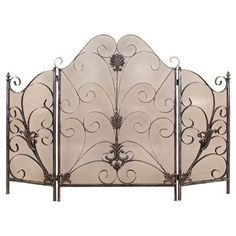 Paneled metal fireplace screen with a tarnished silver finish and scroll accents.  Product: Fireplace screenConstruction...