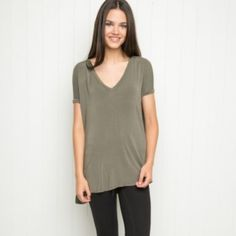 ✨ New Brandy Melville Milan Top ✨ New! Olive green high low cute tee from Brandy Melville. Super soft and easy to style! Brandy Melville Tops Tees - Short Sleeve
