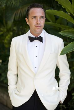 """White & Black Wedding Suit with Black Bow Tie - This would be lovely for the Groom, that way all of his groomsmen would be in classic black tuxedos. So """"Old Hollywood Glam."""" <3"""