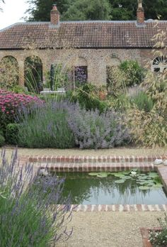 Low maintenance simple garden with Mediterranean flair. Use pea gravel, lavender, sage, grasses, catmint, coneflower.
