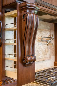 This pull-out spice rack is concealed behind the large wood corbels.