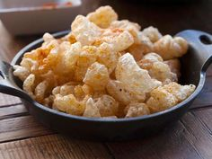Pork rinds, pork cracklins... here in Tucson they are called Chicharonnes and they are perfect Happy Hour food. These are seasoned with Chili and lime from Penca. Food photography by Jackie Alpers for the Food Network.