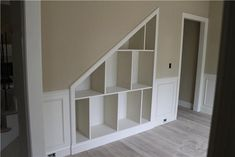 Stair wall shelving for a finished basement