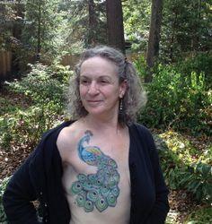 Beautiful peacock. Mastectomy scar coverage.