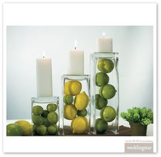 Inverted vases with citrus fruit and candles for another centerpiece idea