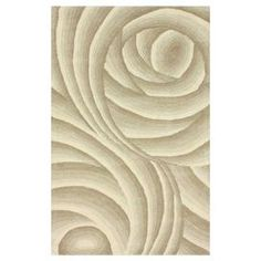 Bring chic style to your master suite or home office decor with this hand-tufted wool rug, showcasing a breezy swirl motif for a touch of timeless elegance. Made in India.   Product: RugConstruction Material: WoolColor: BeigeFeatures:  Hand-tufted Swirl motifMade in India  Note: Please be aware that actual colors may vary from those shown on your screen. Accent rugs may also not show the entire pattern that the corresponding area rugs have.