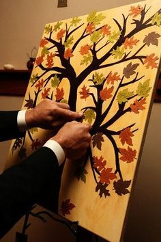 Paint a bare tree and have leaf cut outs for guests to sign then have them attach them to the tree